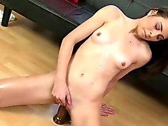 small tits model fucks big toy cock