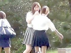 Asian teens piss outdoors