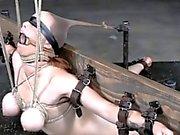 Gagged restrained busty sub slut punished