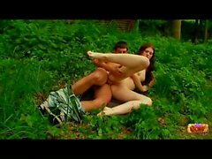 Teen sex in a green forest