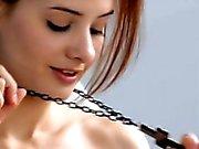 Pretty teenie Anna Tatu stripped down her top