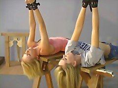 Two blondes wake up in warehouse for bdsm roleplay