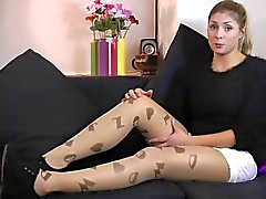 Carly wears unbranded Letter tights