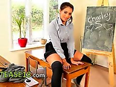 beautiful schoolgirl doing striptease