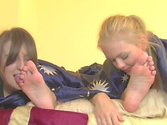 Two girlfriends worshipping feet