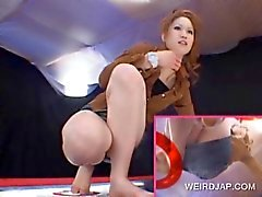 Redhead Japanese flashes her sexy panties upskirt