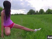 Solo brunette fingers her pussy outdoors