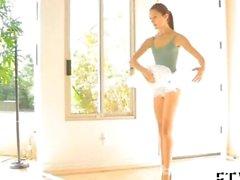 brunette ballerina is having fun with her clitoris