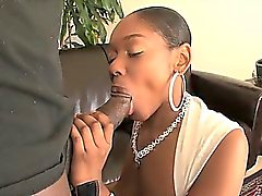 Busty black chick swallowing thick cock
