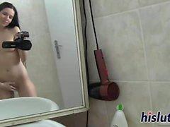 Desirable Vanessa masturbates in the shower booth