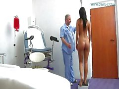 Hot young brunette babe Frida visits the gyno doctor for a pussy exam
