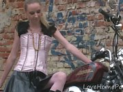 Cute teen is amazed by a big bike