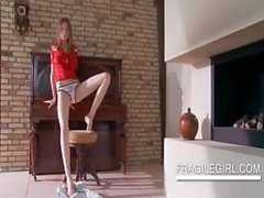 Horny teen strips sensually on a chair