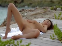 mongolian angel teasing by the ocean