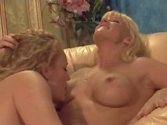Hot cowgilr is licking sexy blonde's moist twat