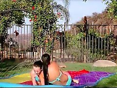 Splendid teen lesbos making out passionately in the garden