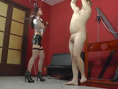 Young ladies whipping male slave