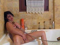 Curvy Ana Marco enjoys masturbating in a bathtub