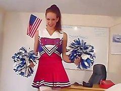 Brunette Cheerleader Showing Off Her Assets