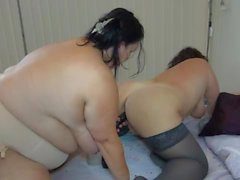 Fat old lady and young chick dildo fuck lustily