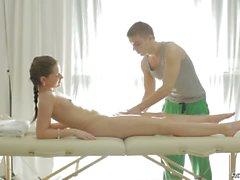 Lovely brunette teen gets massaged and oiled