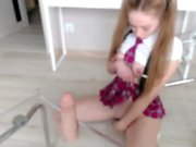 Innocent looking teen takes big dildo in her ass