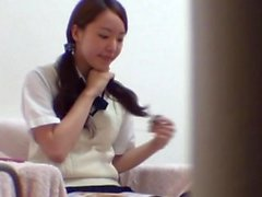 Asian sweetie masturbates