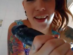 tattoo girl play with dildo