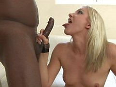 White skinned babe fills her mouth with black long cock on a white couch