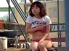 Young japanese masturbates in the park