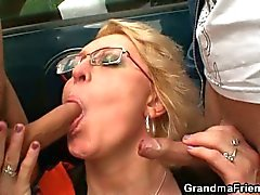 Mature gets fucked in the fields by two studs
