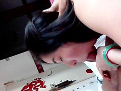 Oriental teen works her mouth on a big dick and swallows a hot cumload