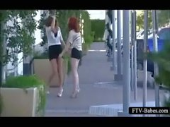 Excited teen lesbo lovers making out in public