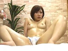 Sexy Asian teen is all oiled up and gets a rubdown while to