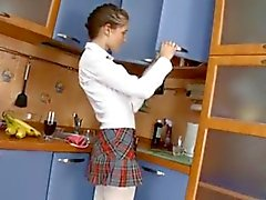 Russian schoolgirl gets fucked in the kitchen