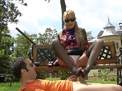 Hot slut uses her mouth and feet