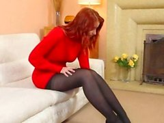 Redhead in nylons finger in red shoes