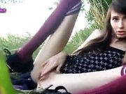 nympho teen masturbates in the grass
