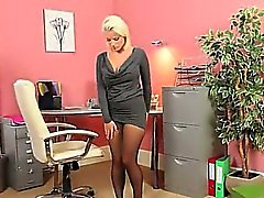 Exclusive blonde model in office