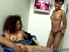 Young ebony beauties go naughty with a big glory hole stuck