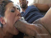 Raunchy Layla Storm chokes on a massive thick meat pole