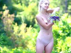 beautiful girl loves flowers