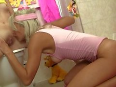 Young blonde and brunette lesbians have some fucking fun in the bathroom
