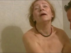 Mature gal and young guy shower together