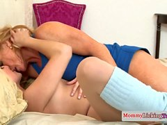 Gorgeous stepmom massaging teens feet