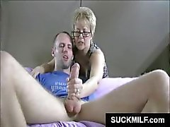 Mature MILF strokes and sucks on a young stud's erect member