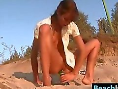 Petite Teen Riding A Bottle At The Beach