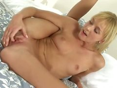 Young blonde Hanna masturbates with two fingers
