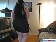 Busty BBW brunette is posing and stripping on her home webcam