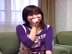 Japanese asian girl giving blowjob for guy on the bed